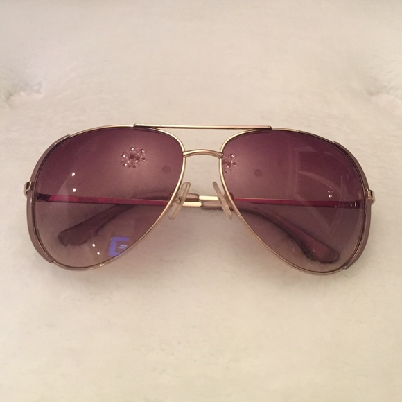 f1b87b525ff2 Michael Kors Gold Oversized Aviator Sunglasses. M_5555797ca06f807271004936