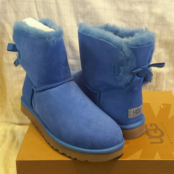 63f7840b61c Sold. Ugg mini bailey bow blue snow boots 10 NWT