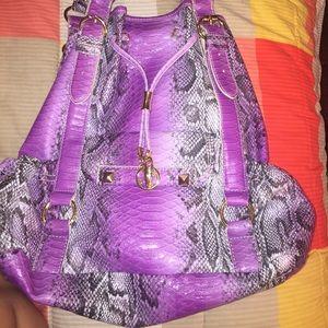 Brand New IMAN Handbag- HOLDING