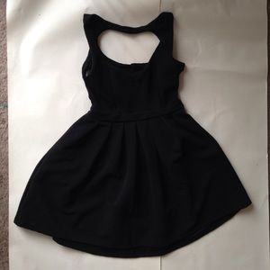 Poof Couture Dresses & Skirts - Black flowy dress with heart shaped open back