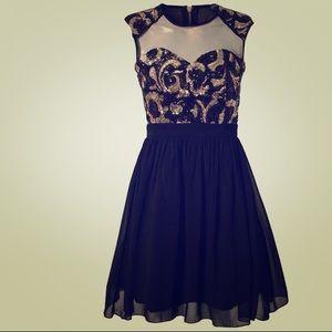 ManGa Dresses & Skirts - Black And Gold Dress
