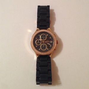 DKNY with rose gold face and black band!