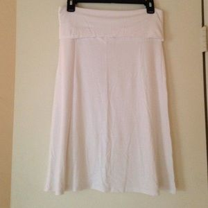 White cotton fold over skirt. Knee length.