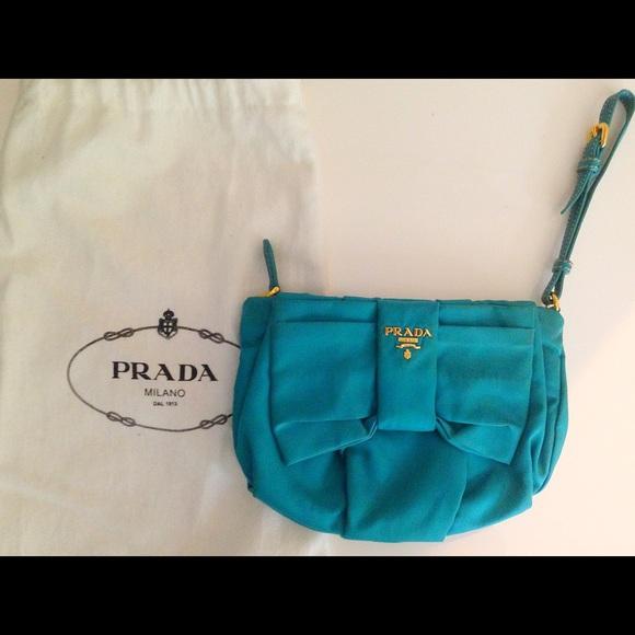 528f32c9993a47 Prada Turquoise Nylon Bow Wristlet Clutch Handbag.  M_555a6ff7729a6630cc00f6e4