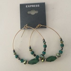 Gold hoop dangly earrings with green beads