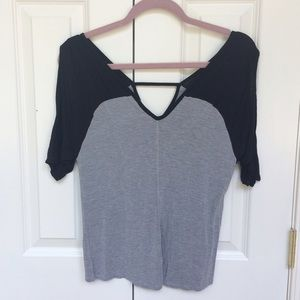 Gray and black tee shirt with open triangle