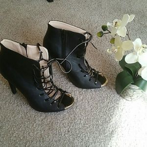 Lace up black man made leather booties