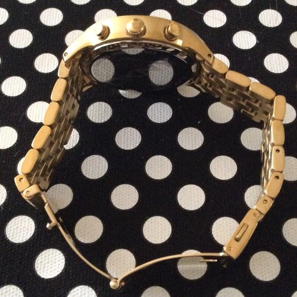 DKNY Jewelry - 💕SALE💕DKNY gold link bracelet, pearly white face