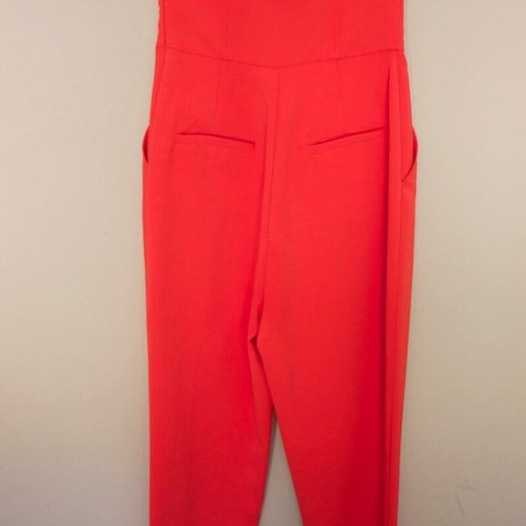 9f7b3594e32b Rachel Roy Strapless orange jumpsuit. M 555fb2a79c6fcf78fc000b36