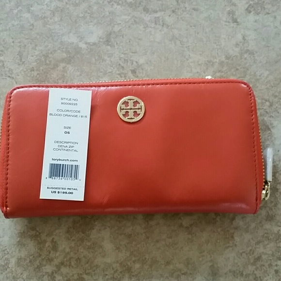 f589f9a8495 Auth. Tory Bury orange leather wallet