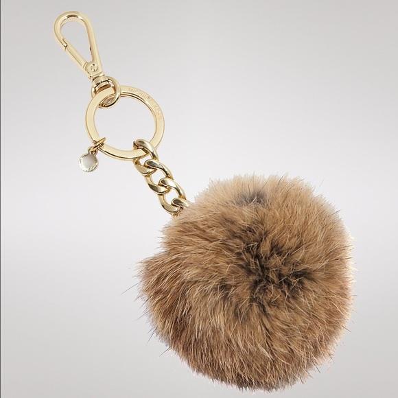 Michael Kors Fur Pom Keychain. M 556238a641b4e025f1008d79 841b54293