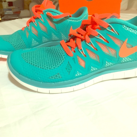 new concept 528d1 31ed9 New Nike Free Run 5.0 size 7.5 teal and Orange! NWT