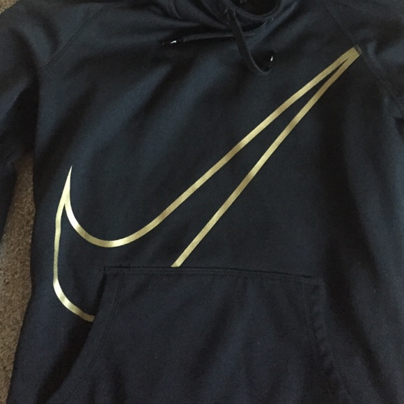 black and gold nike shirt