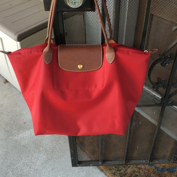 0bc4ff2a058d Longchamp Handbags - Auth Red Longchamp Large‼️ON HOLD atwelllauren ‼