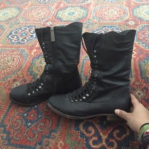 Laced up black combat boots