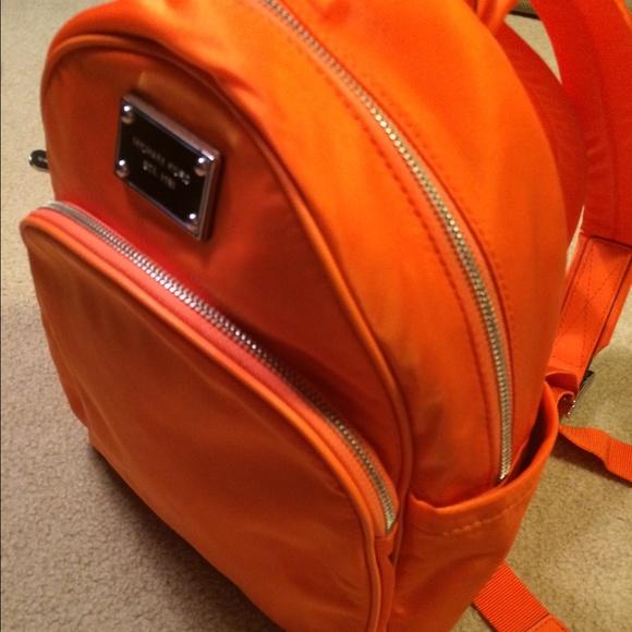 7e5998ba0ebb Bright Orange Michael Kors Small Backpack. M_55665d77f092827a8101799f