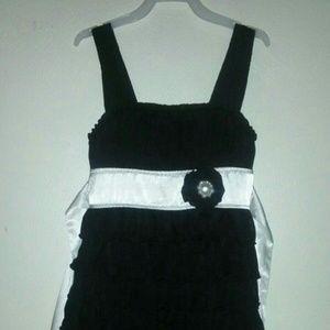 ChildsBlack and white ruffle dress with white sash