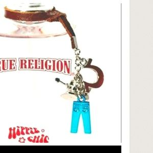 Multipurpose true religion charms on leather strap