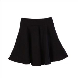 Stretchy black short skater skirt.