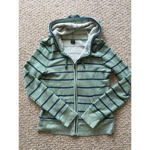 Green and blue striped sweatshirt