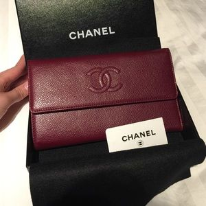 authentic  Chanel L flap wallet in burgundy color.