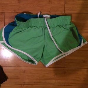 NIKE DRY FIT RUNNING SHORTS MEDIUM (fit like a XS)