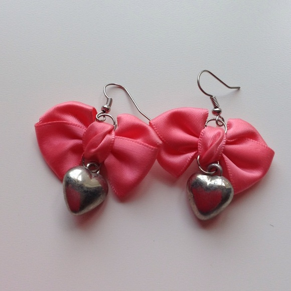 69% off Jewelry - Heart Shaped Bow Earrings from Melissa's ...