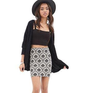 Dresses & Skirts - Tile print jersey mini skirt