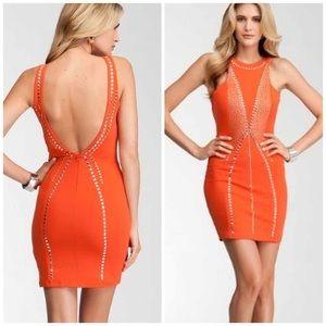 🎉HP🎉Bebe Addiction Orange Studded Dress!