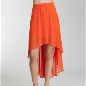 🎉HP🎉NWT Bebe orange high low chiffon skirt sz M
