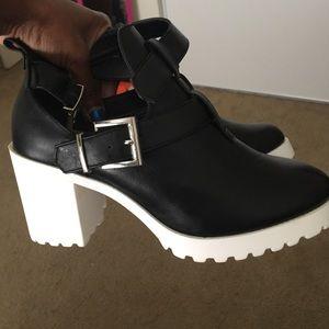 Black & white open ankles boot-like heels