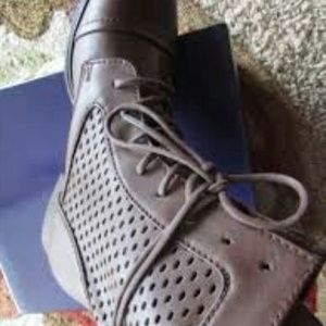 Brand new Steve Madden perforated combat boot