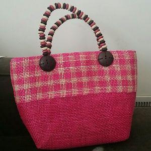 Pink woven shoulder bag