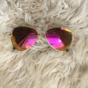 Iridescent mirrored orange and purple sunglasses