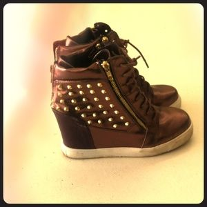 Goldish brown sneaker wedges .