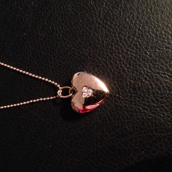 9cb1ba463 Tiffany's 18k rose gold heart locket pendant. M_55ef34cefeba1f9113022601