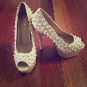Nude stud heels