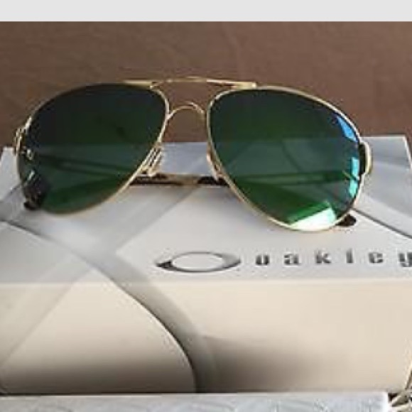 ac30ecb4d1 Oakley caveat polished gold with Jade Iridium