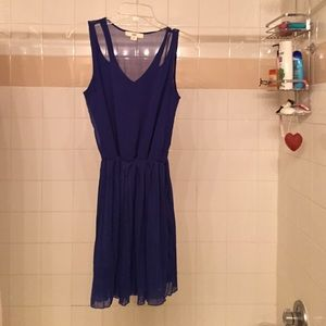 Blue dress with sheer back and pleated skirt