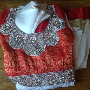White and red salwar kameez