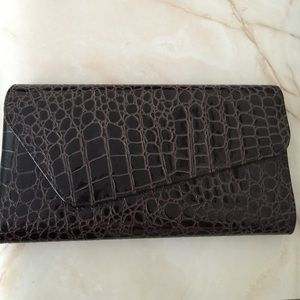 Brown alligator inspired leather clutch