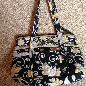 Purse--black, gold and white print.