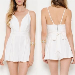 """Off Duty"" White Low V-neck Romper with Bow"