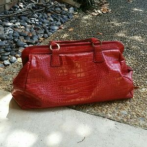 Red leather tote bag with double Zipper closure