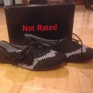 black/argyle pattern Oxford shoes. never worn.