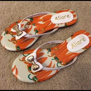 Shoes - White and orange flip flop