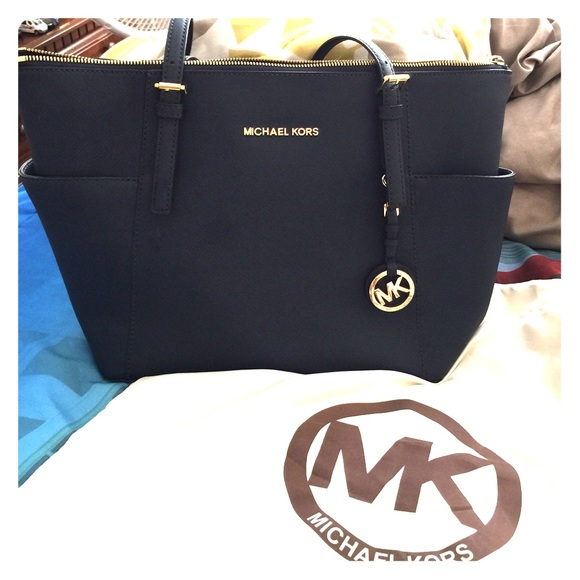 3c081ea9f48f Michael Kors Jet-Set Top Zip Saffiano Leather Tote.  M_5589651d4837e357f1002e2a