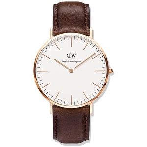 Daniel Wellington: Rose Gold with leather band.