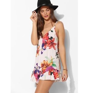 Reverse Floral Ruffled Romper