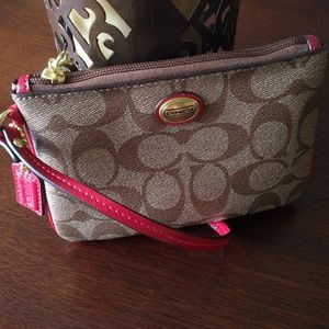 Coach signature wristlet with red trim